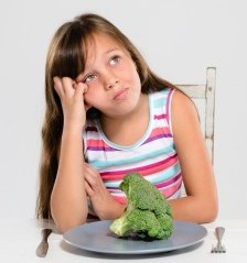girl and broccoli